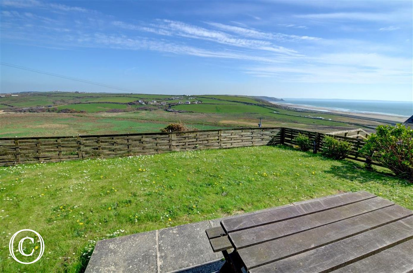 The patio and lawned garden have lovely views over fields and Newgale Sands