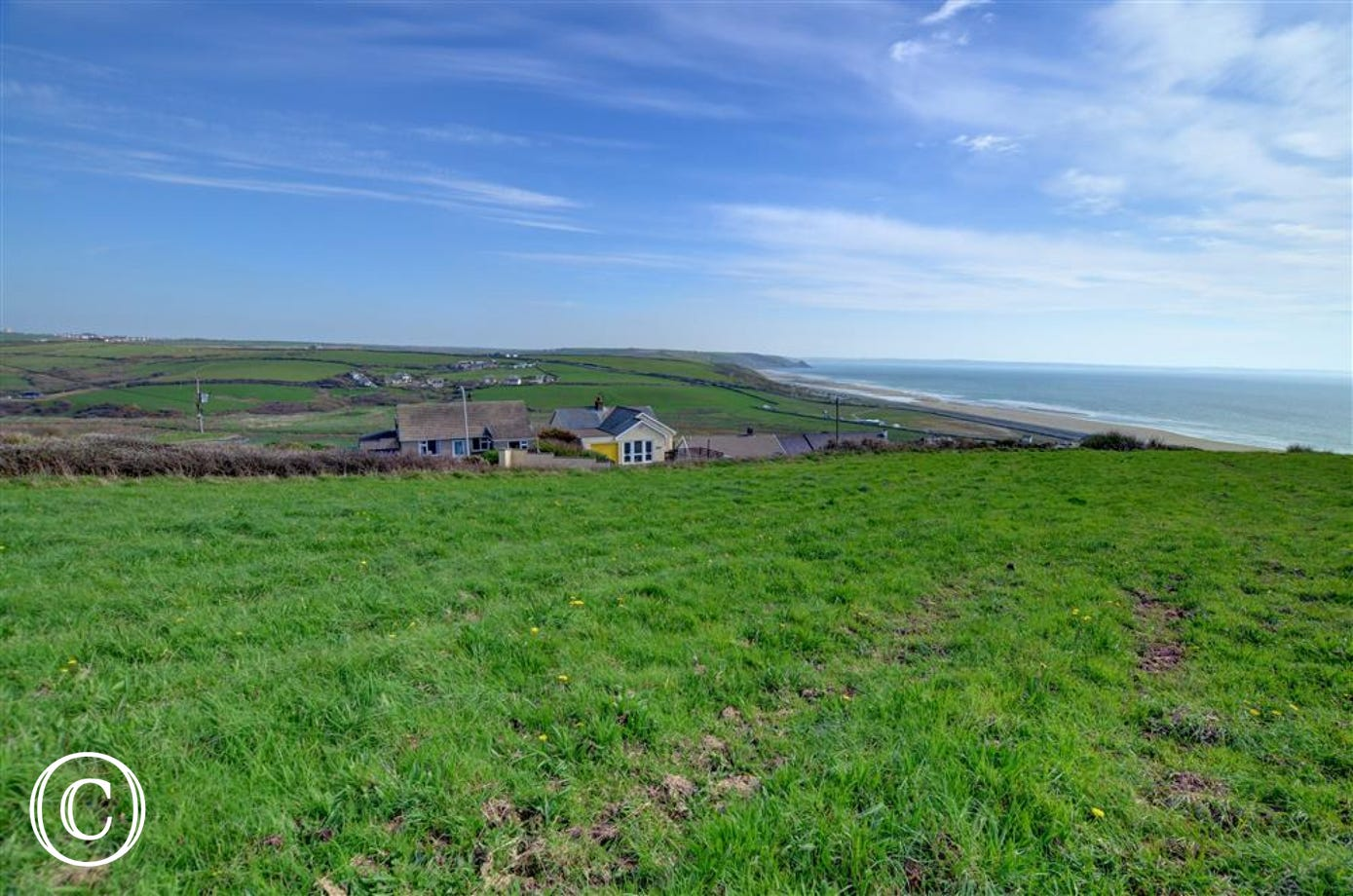 The property has a wonderful view over surrounding fields and coastline