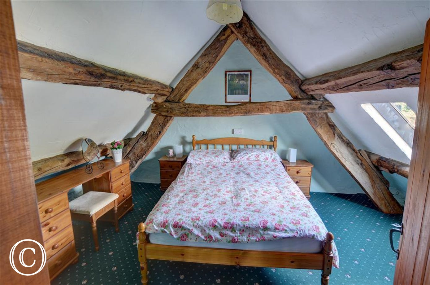 The original cruck frame of the barn is in the attractive double bedroom