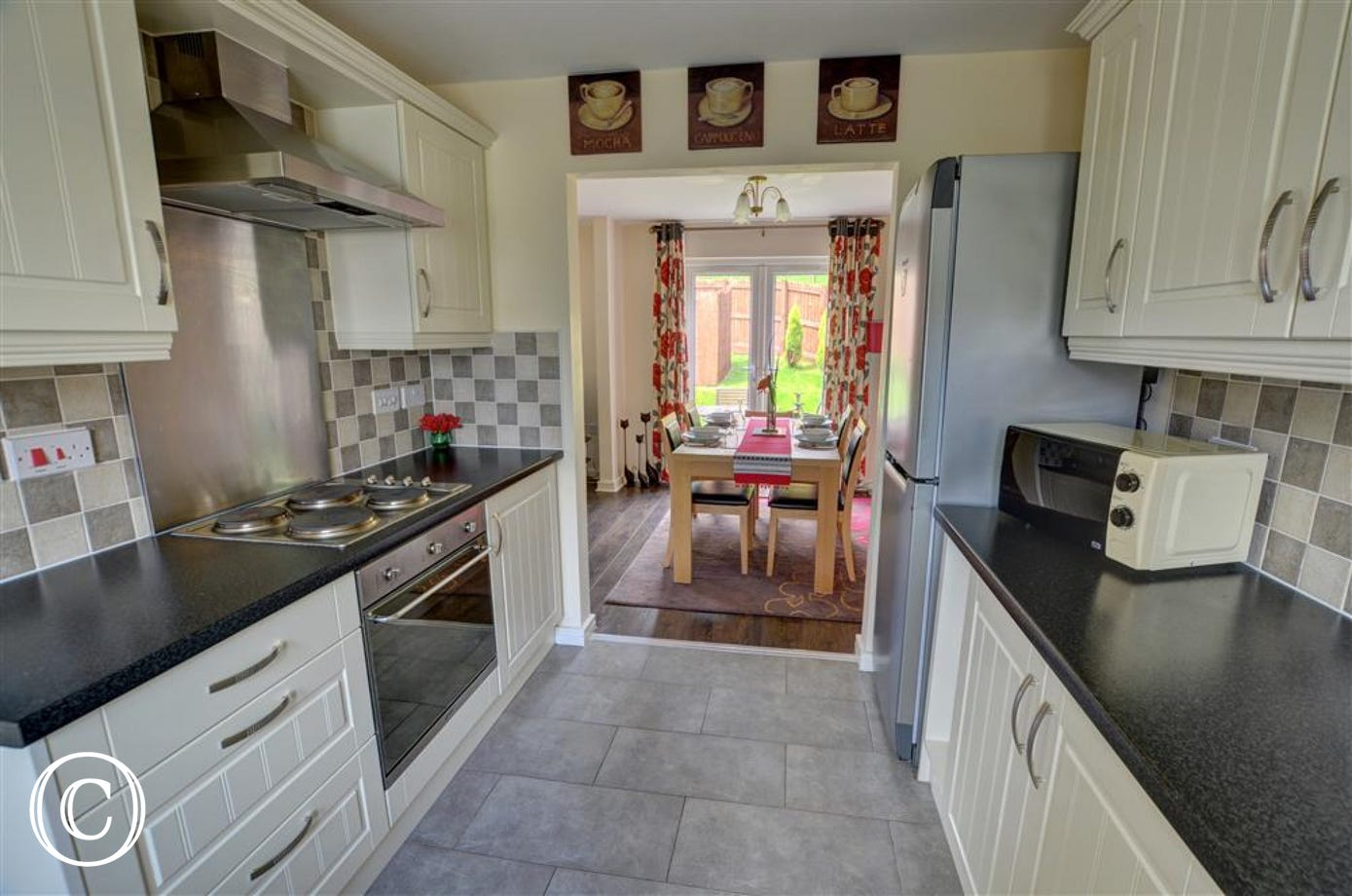 The attractive kitchen leads to the dining area and out to the garden