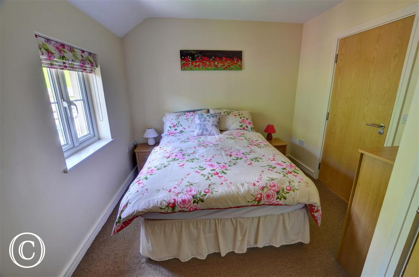 The main double bedroom has attractive furnishings