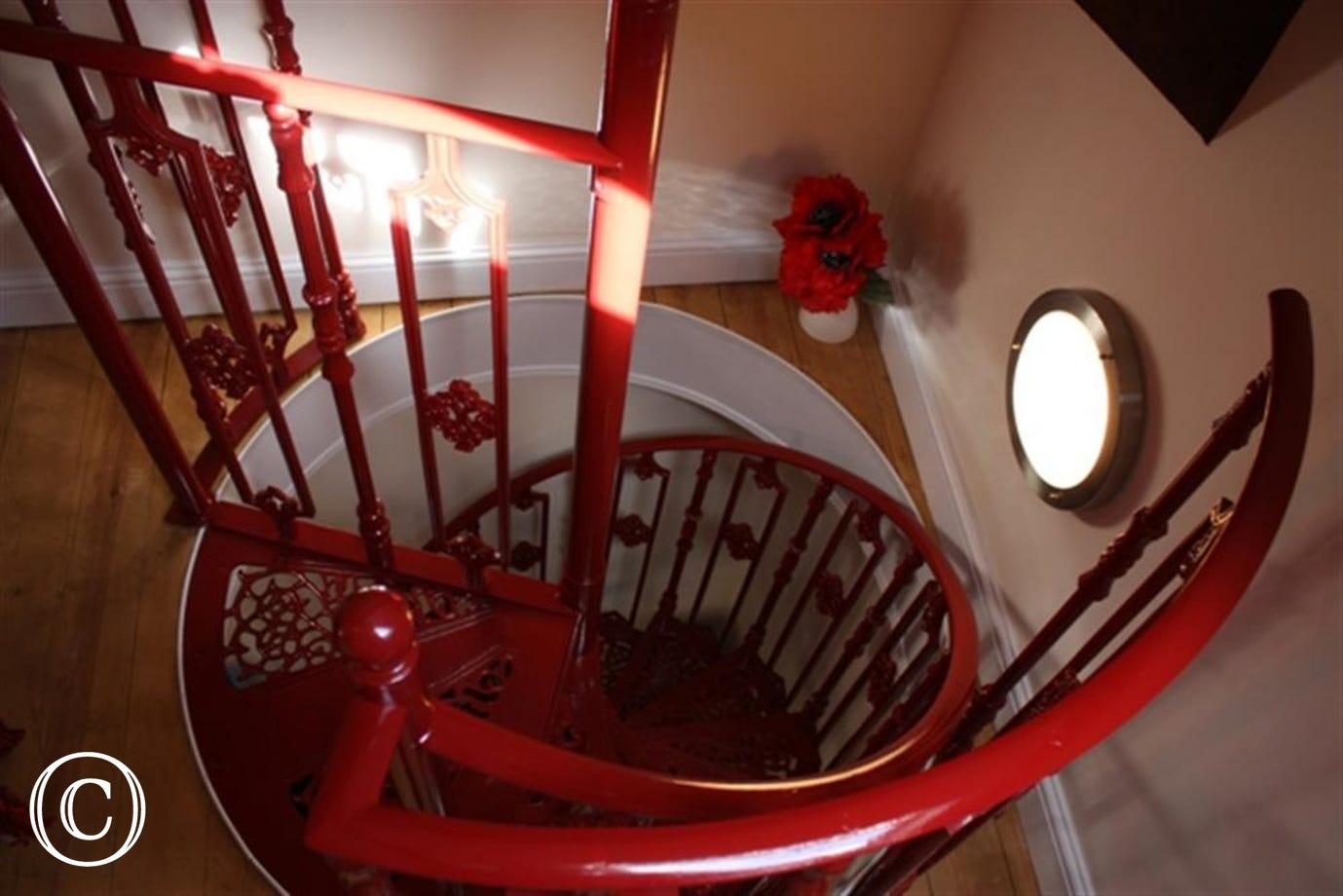 Feature spiral staircase leading to double bedded room only.