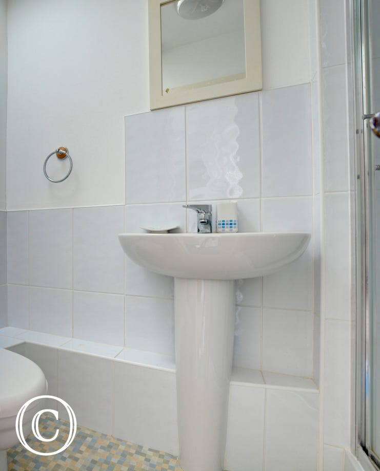 Compact shower room with shower cubicle, wash hand basin and toilet