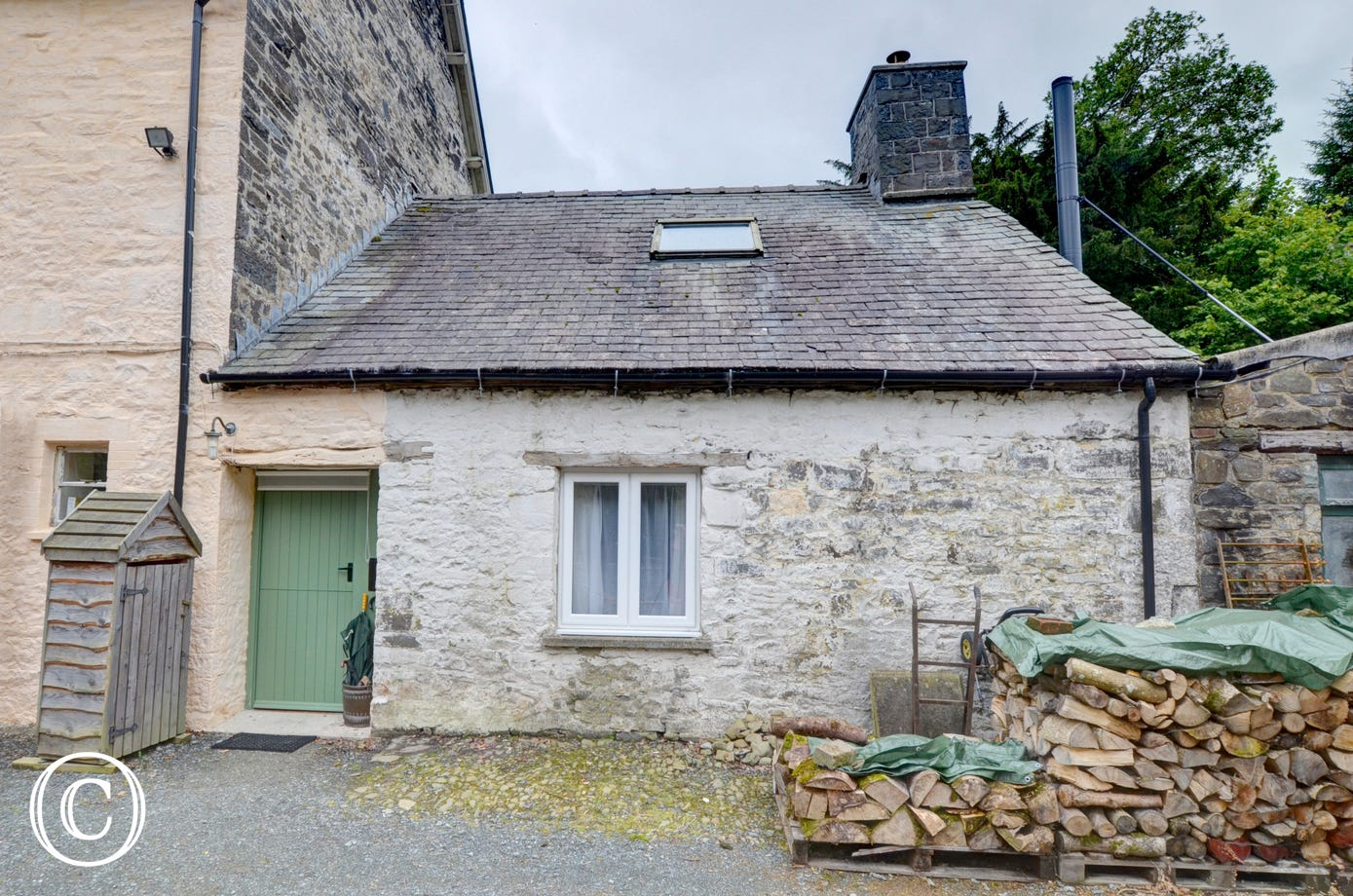 A tiny stone cottage to the rear of the owner's large Country House