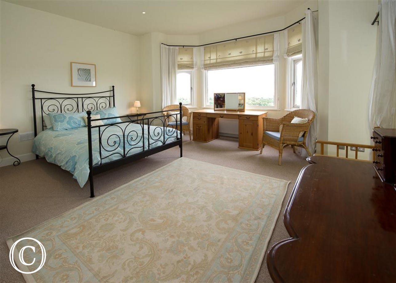 Spacious master bedroom with king size bed and en suite