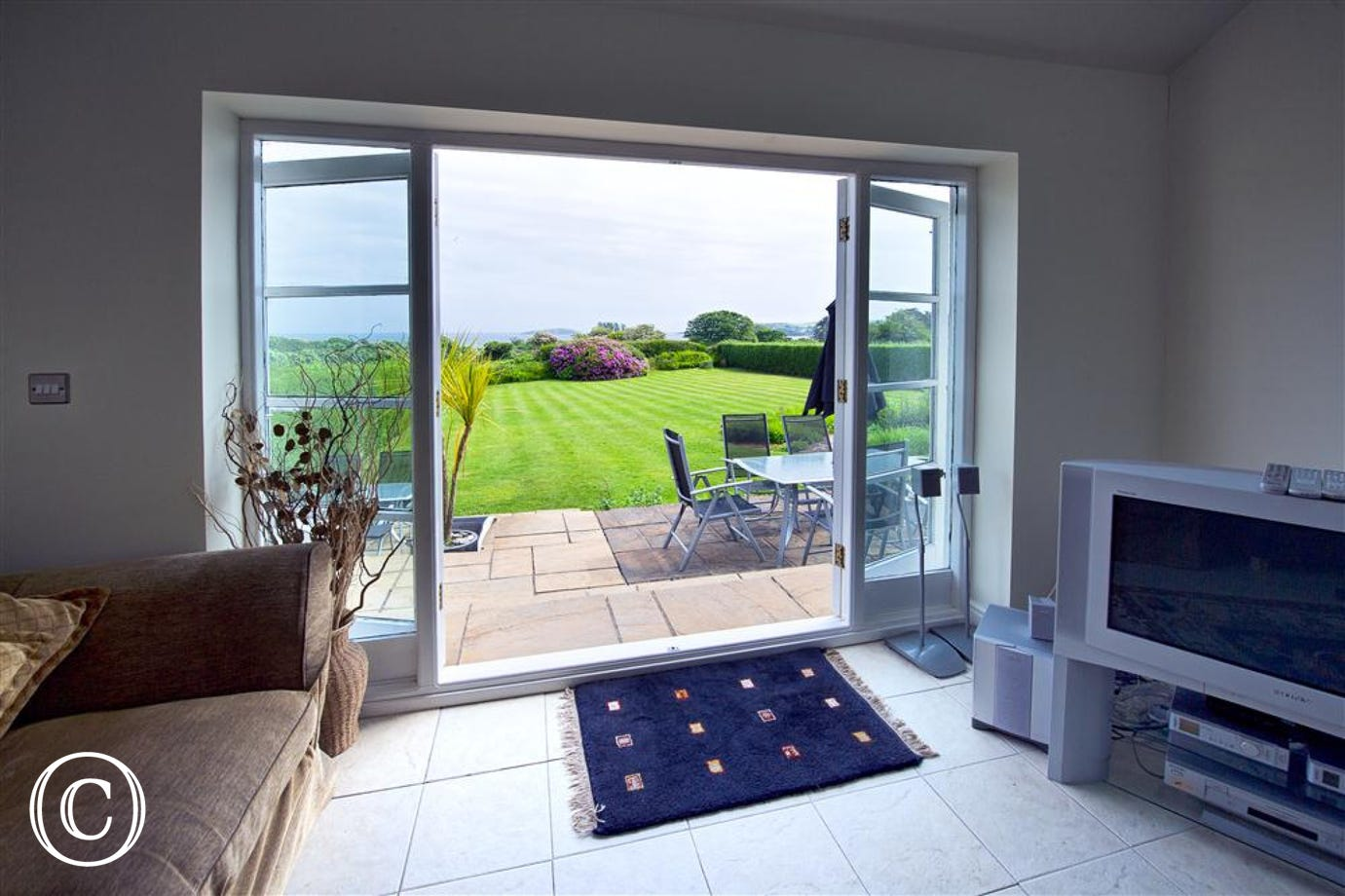 Garden can also be reached through the folding doors in the conservatory