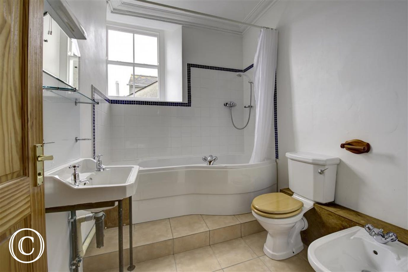 Dressing room leads to ensuite bathroom, with shower over