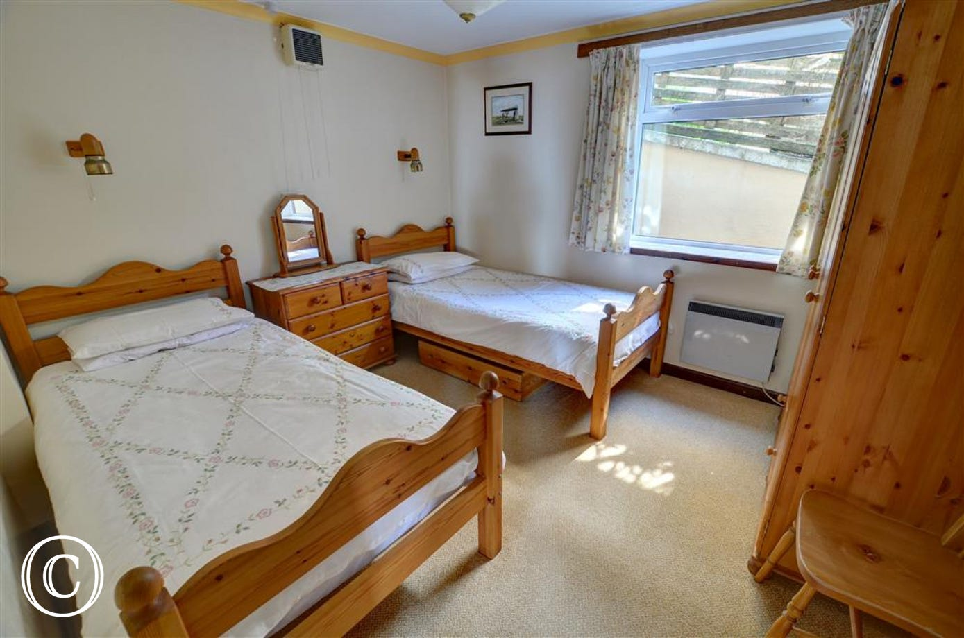 The twin bedroom is also furnished in pine