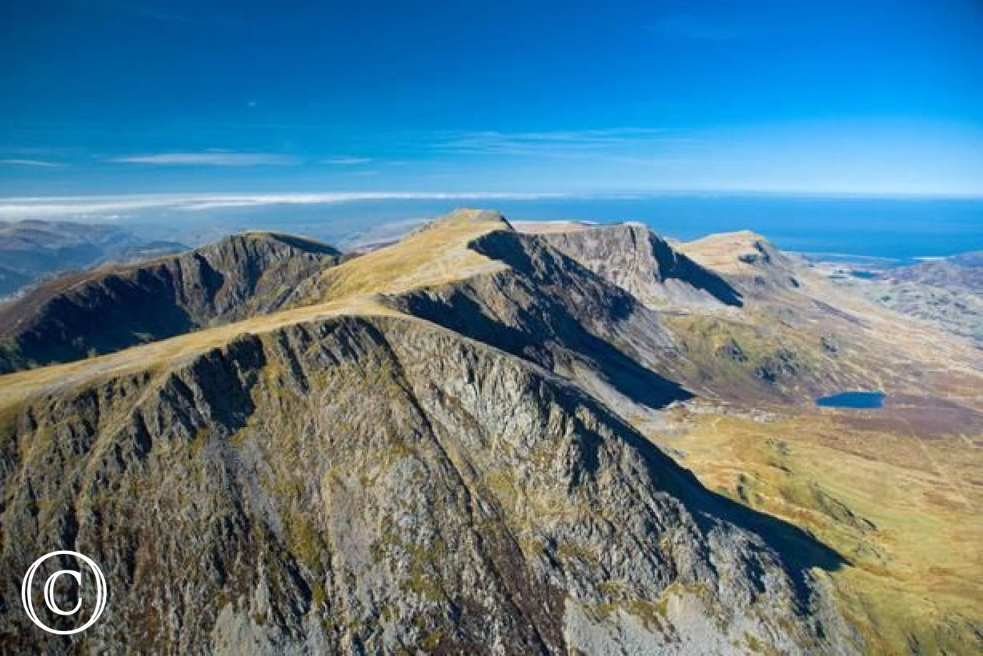 Looking out to the coast from the peak of Cader Idris, Snowdonia