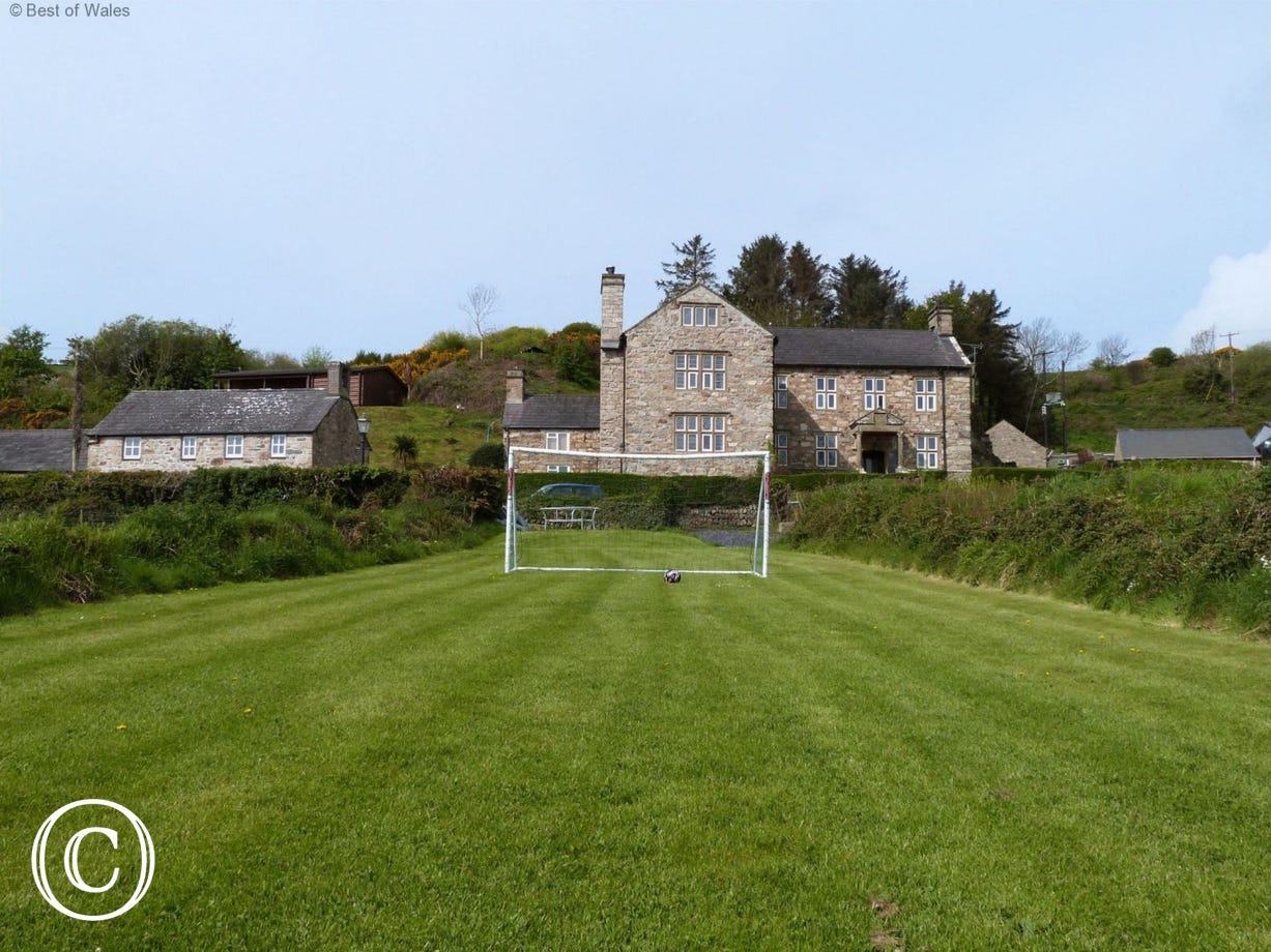 Y Granar (left) and farmhouse on the right. Y Granar is one of the farm's four 5 star cottages to rent in Abersoch.
