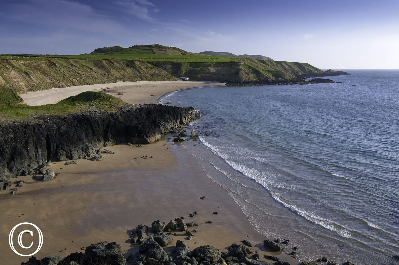 The sand at Porth Oer (5.5 miles) sometimes 'squeaks' under your feet