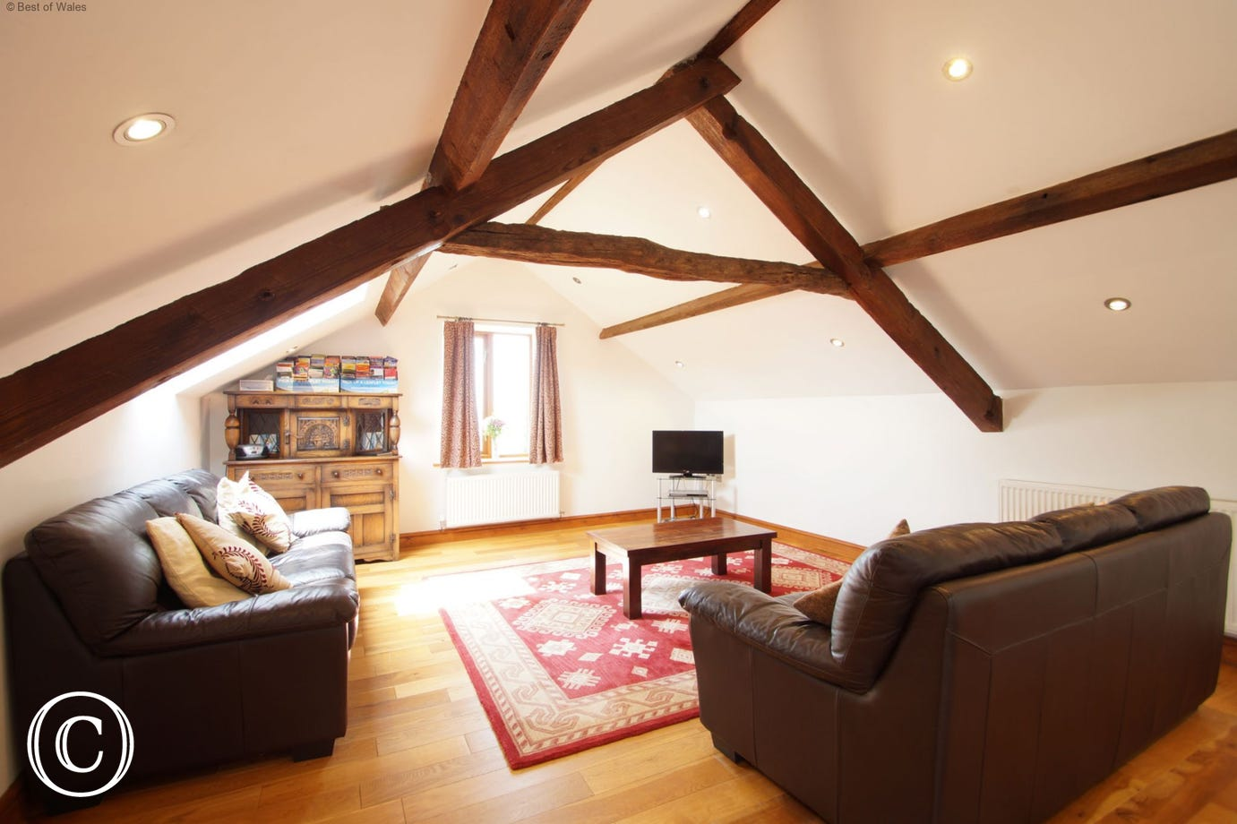 Spacious and cosy upstairs lounge at Beudy Taicroesion holiday cottage