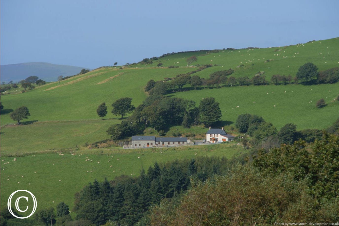 Two 5 star holiday cottages and the owners's farmhouse in a lovely setting. Photo by Storm Development
