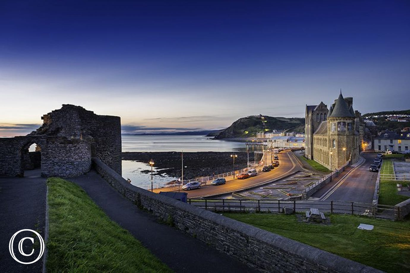 Enjoy beautiful sunsets over Aberystwyth from the castle grounds