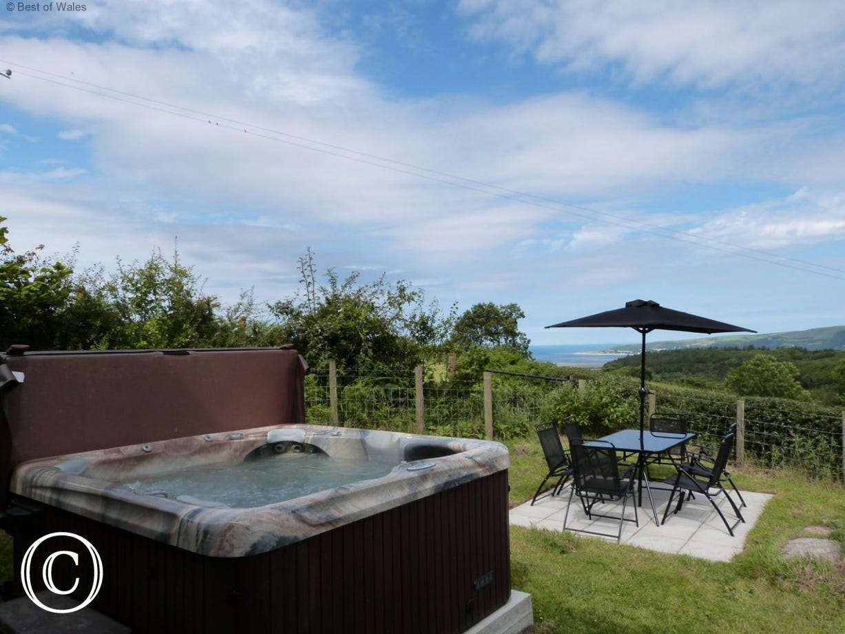 Sea and mountain views from this cottage with private hot tub