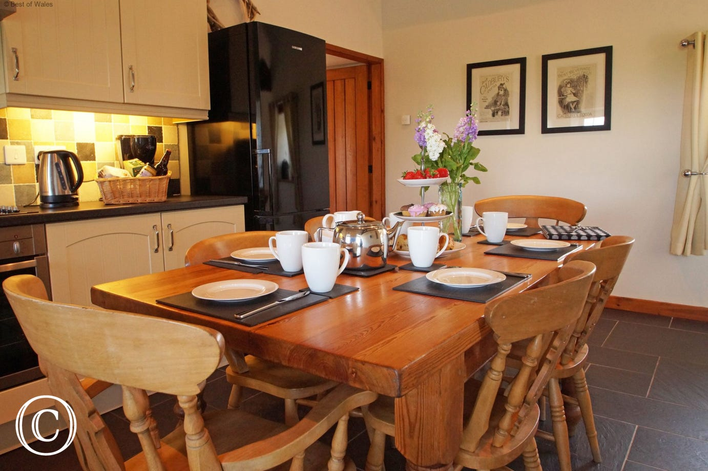 Unit 2: Beudy A spacious, cream 'shaker' style kitchen with a farmhouse pine table.