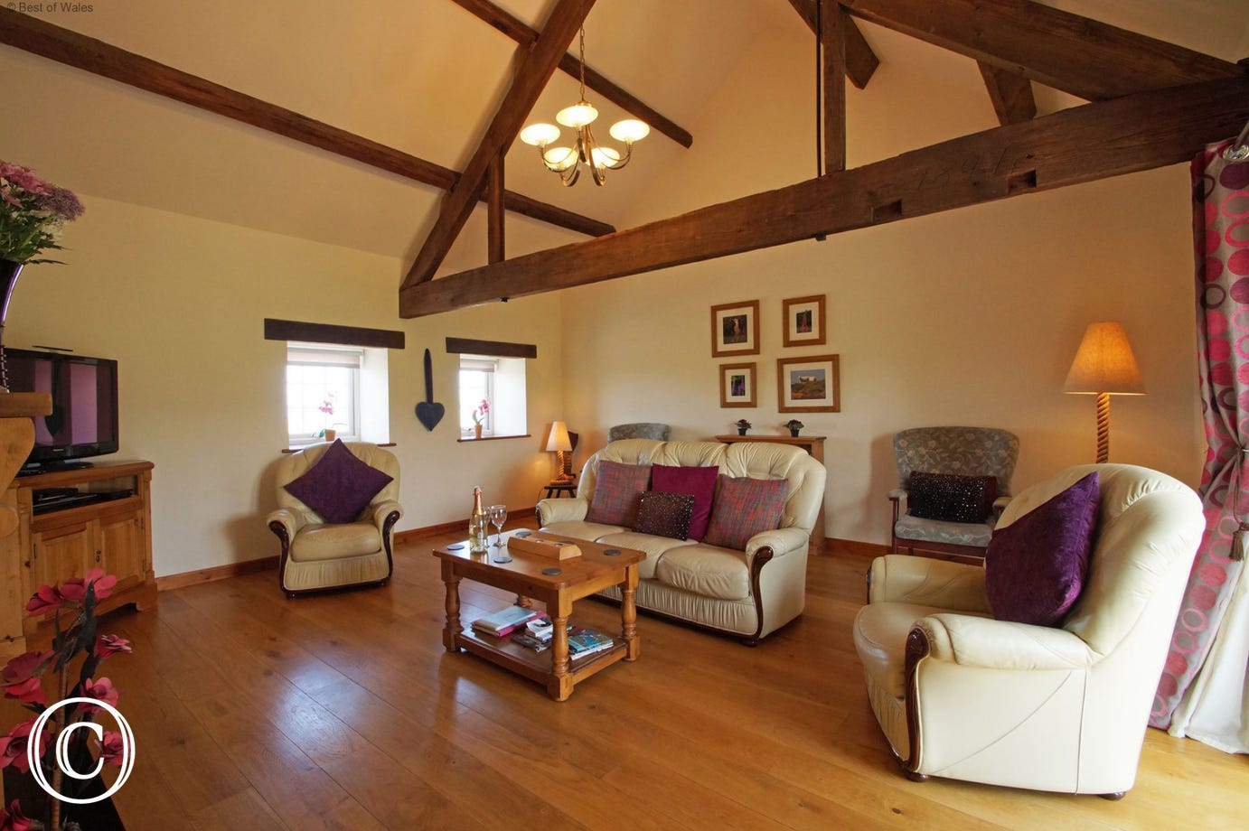 Living room with solid oak floor and comfortable, large leather sofas