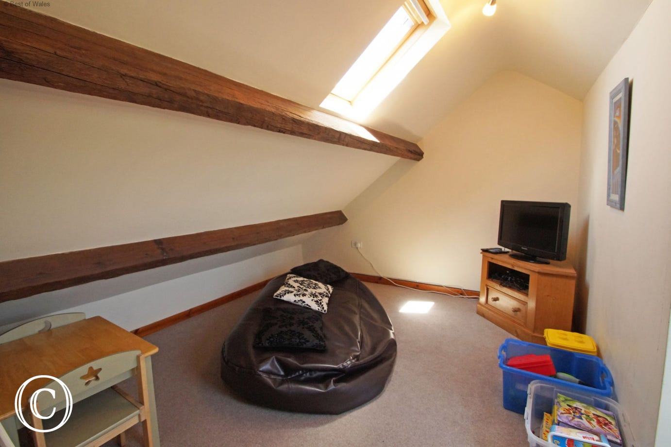 Cosy 'snug' room with TV & games - a perfect retreat for the children.