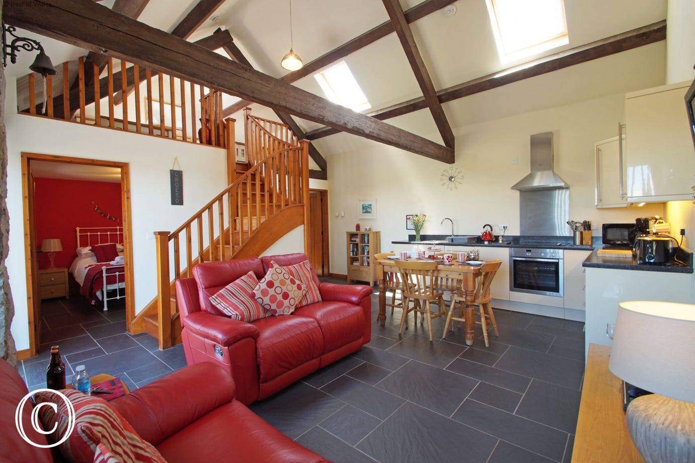 Open plan living area - spacious double height room with beams