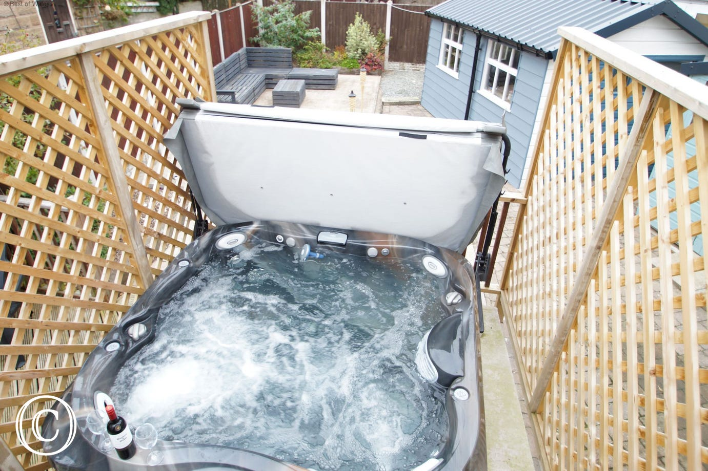 Llandudno self catering house with a large hot tub in the garden