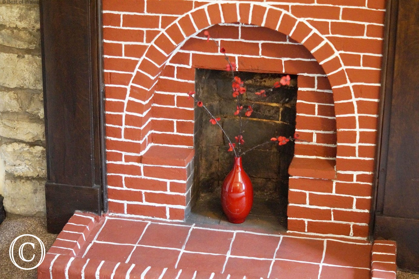 One of the original bedroom fireplaces