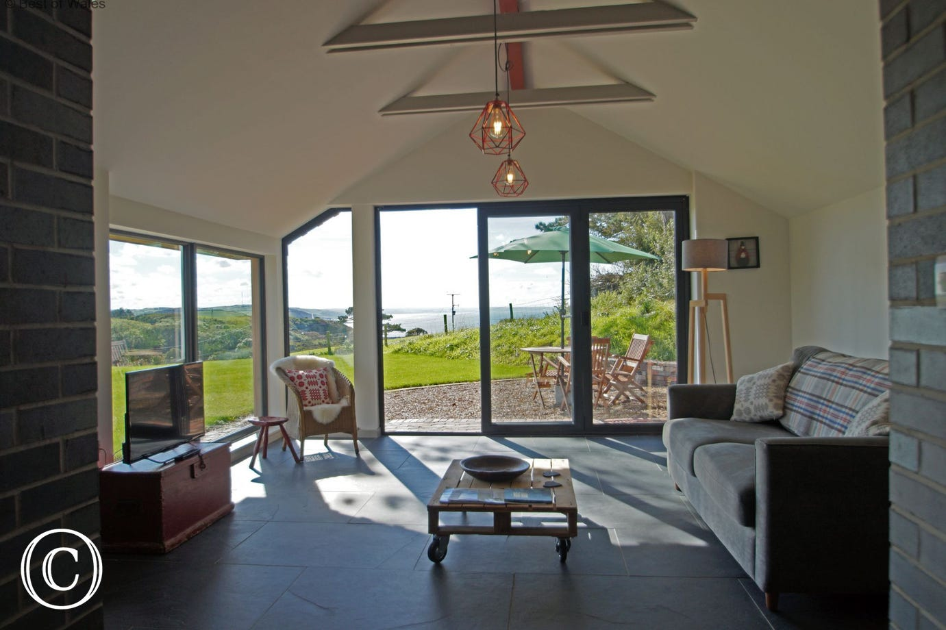 Spacious and light lounge with far reaching views over Cardigan Bay