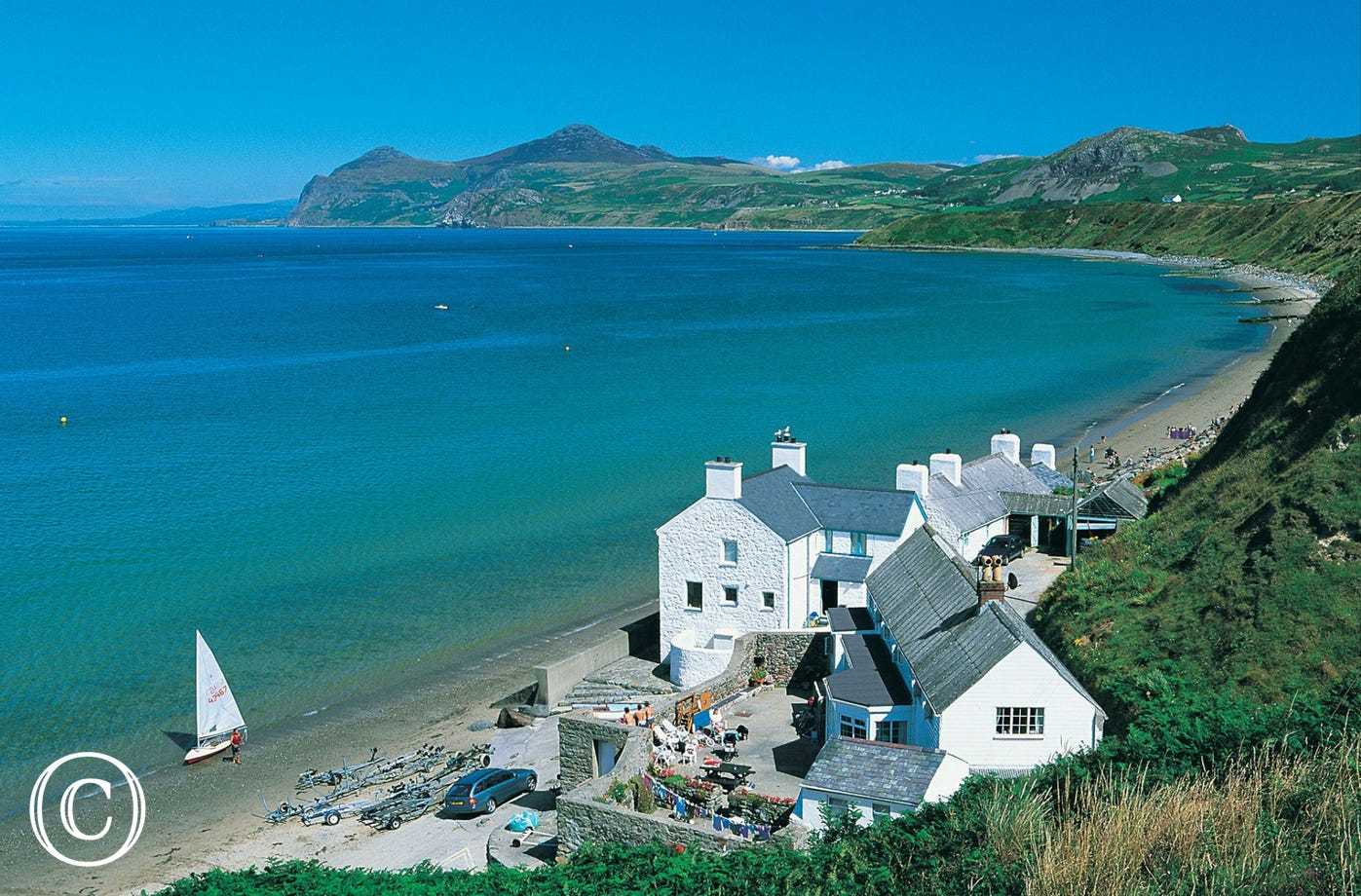 Ty Coch Inn at Porthdinllaen (11 miles) was voted 3rd best beach pub in the world