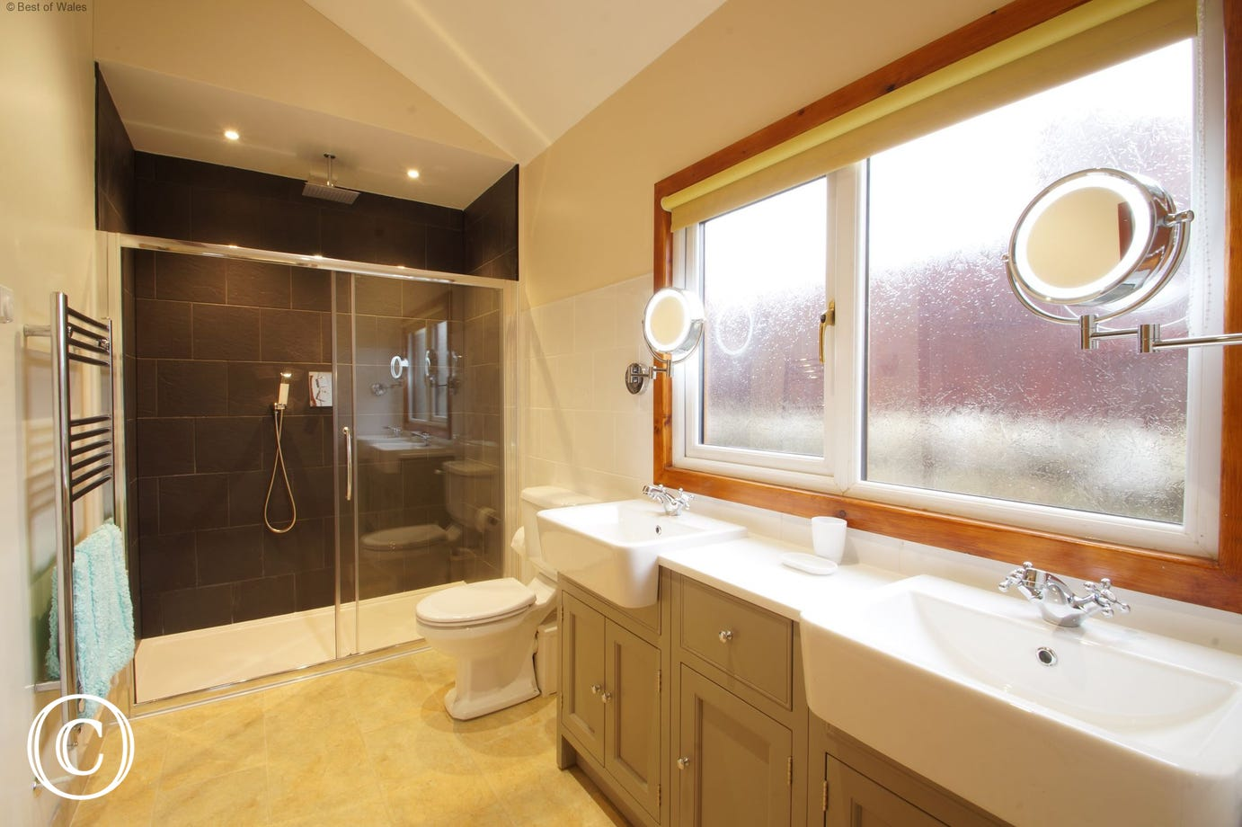 Spacious ensuite shower room with a large double shower