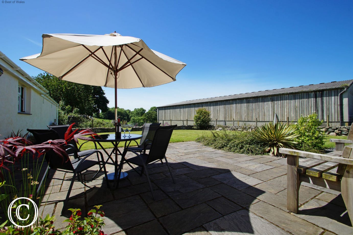 Private patio area and garden furniture in a beautiful, tranquil setting.