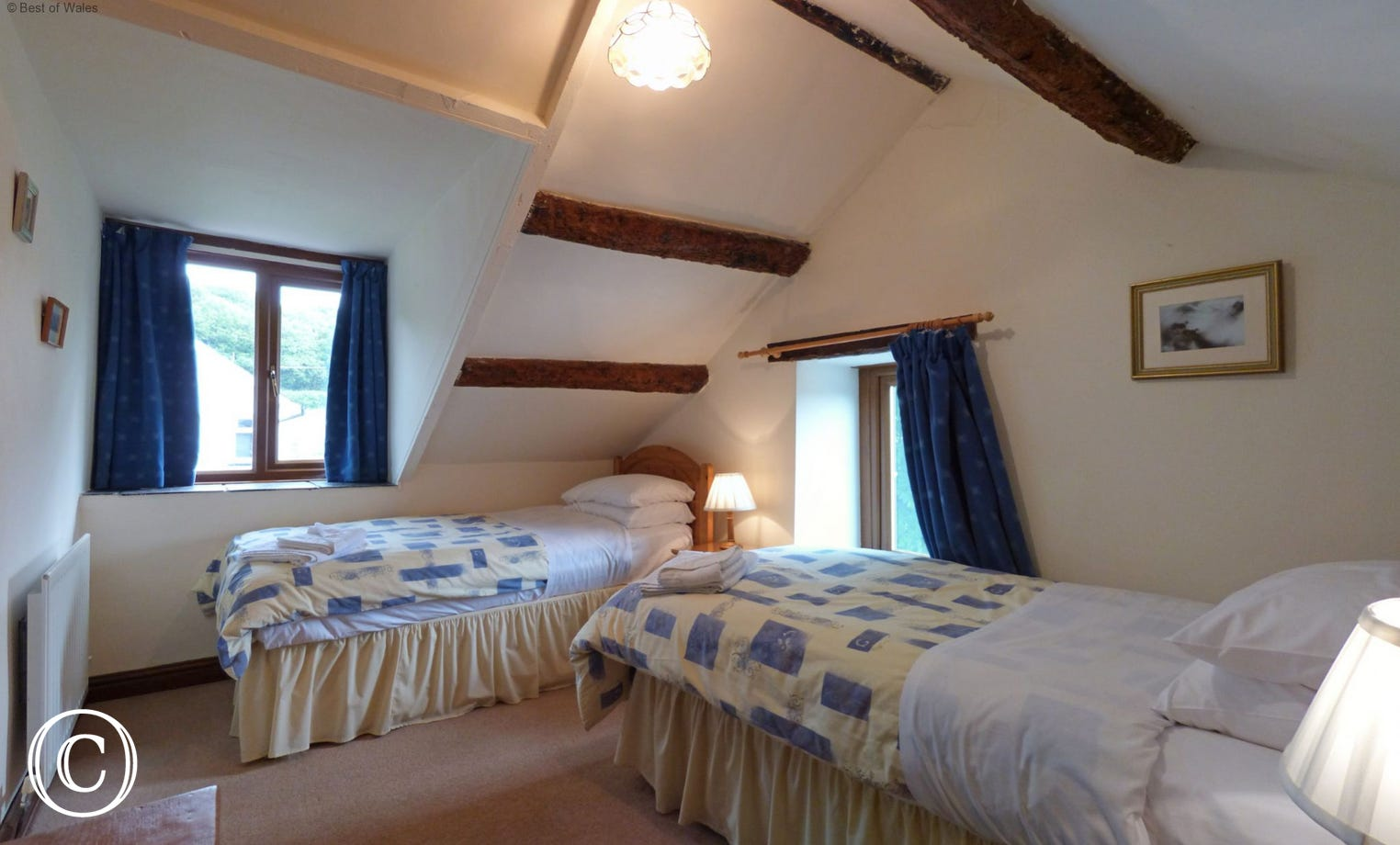 Cosy twin bedroom at Ciperdy's working farm holidays in Wales