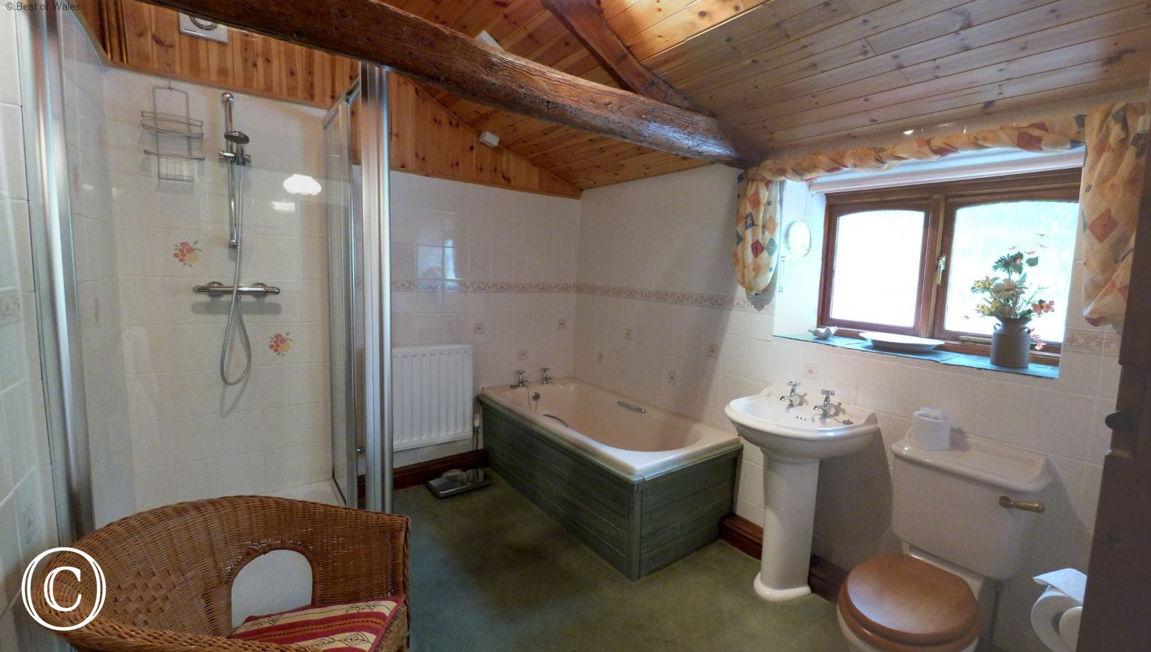 Large downstairs bathroom with full size bath & separate double shower
