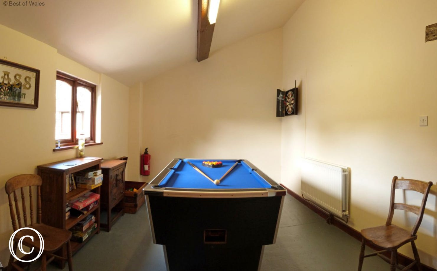 The shared games room on site includes a pool table and dart board.