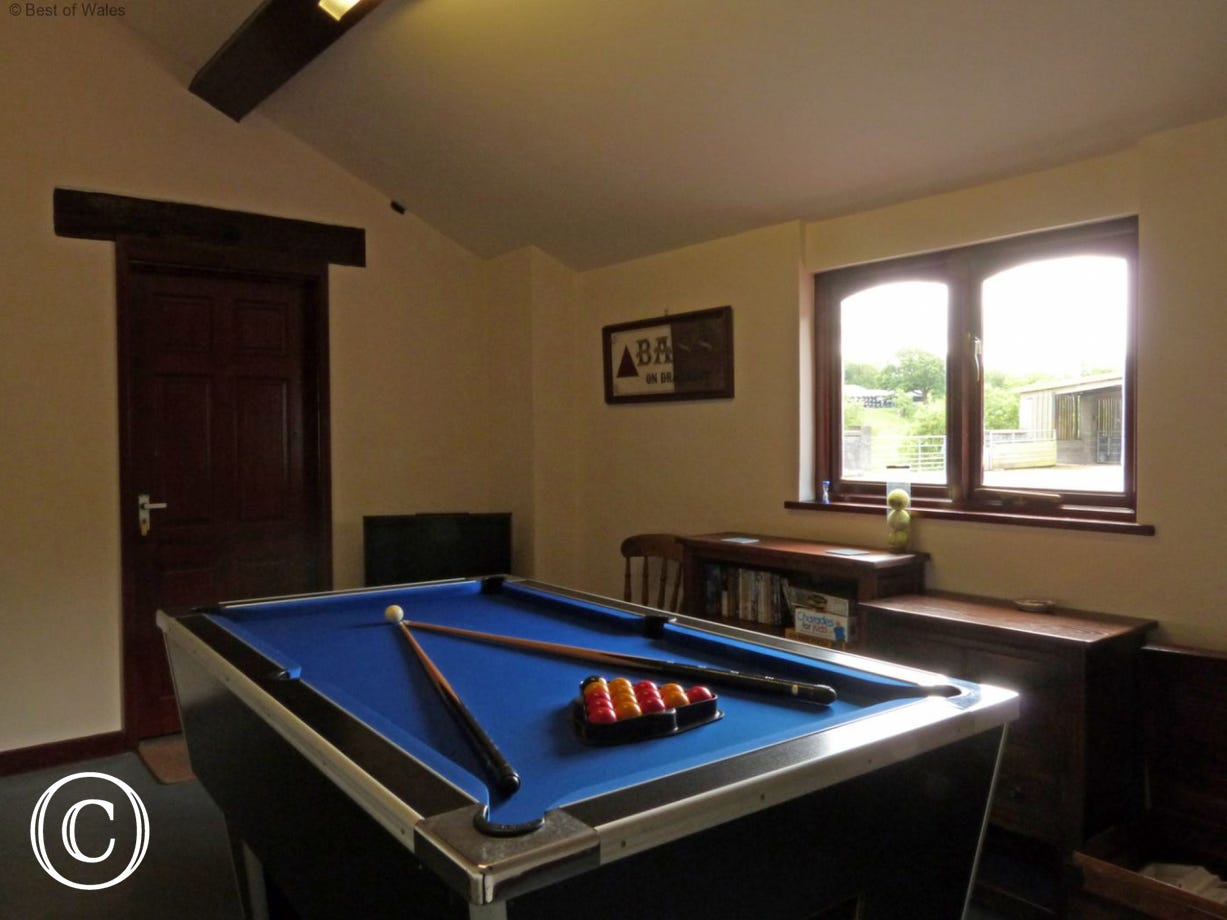 A converted outbuilding on the farm yard also serves as a laundry and games room