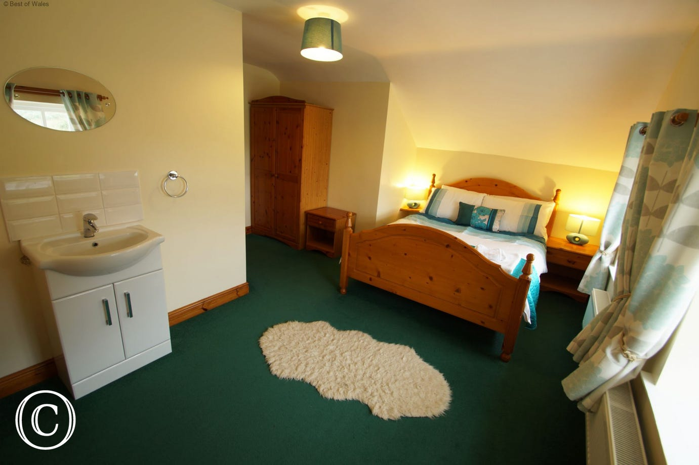 Spacious double bedroom with wash basin