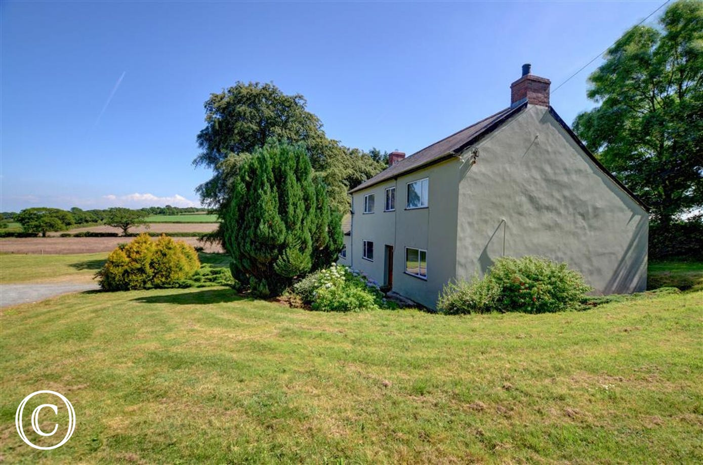 This extremely spacious and very old five-bedroomed farmhouse stands in its own grounds and is surrounded by 50 acres of farmland.