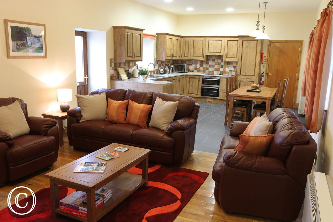Beautiful 5 star cottage, Mid Wales: cosy living area & spacious kitchen