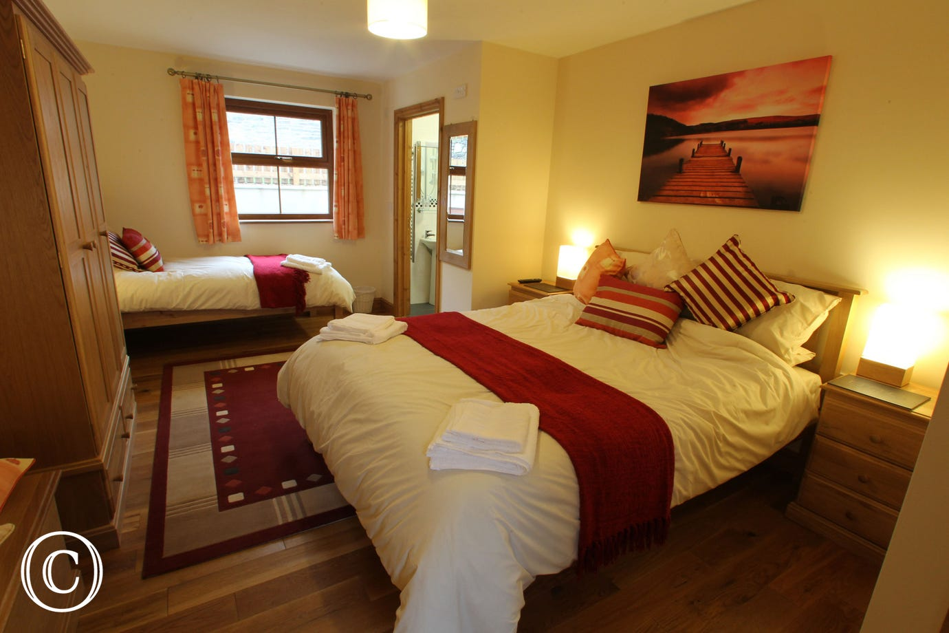 Spacious en-suite family bedroom with king size and single beds