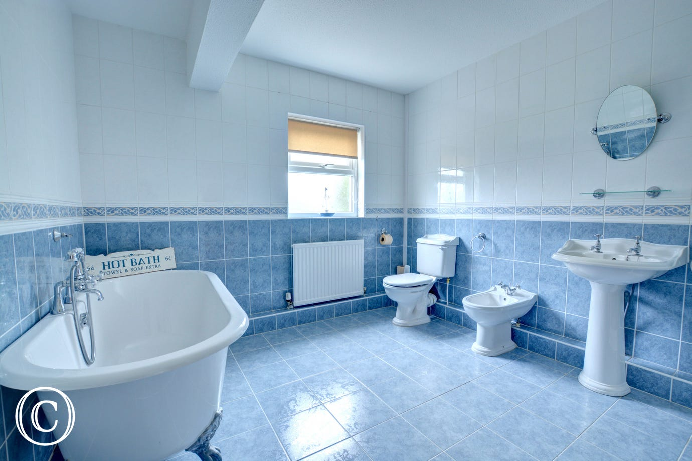 Bathroom with roll top bath, toilet, bidet, wash basin and shower cubicle (out of shot)