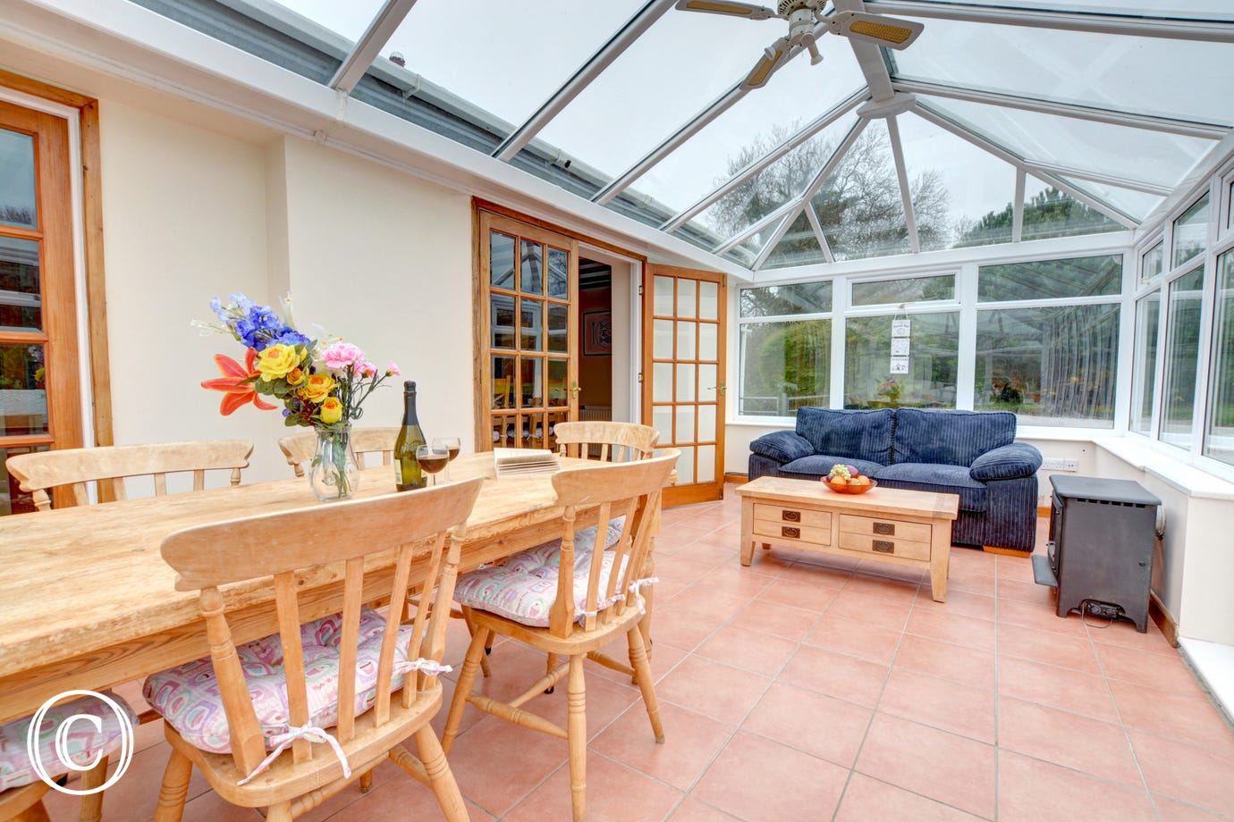 Large conservatory with dining table & chairs and seating