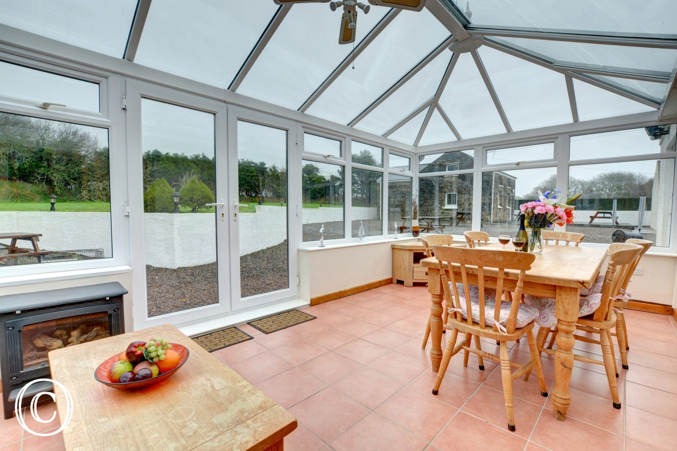 Conservatory which leads out to communal gardens with garden furniture