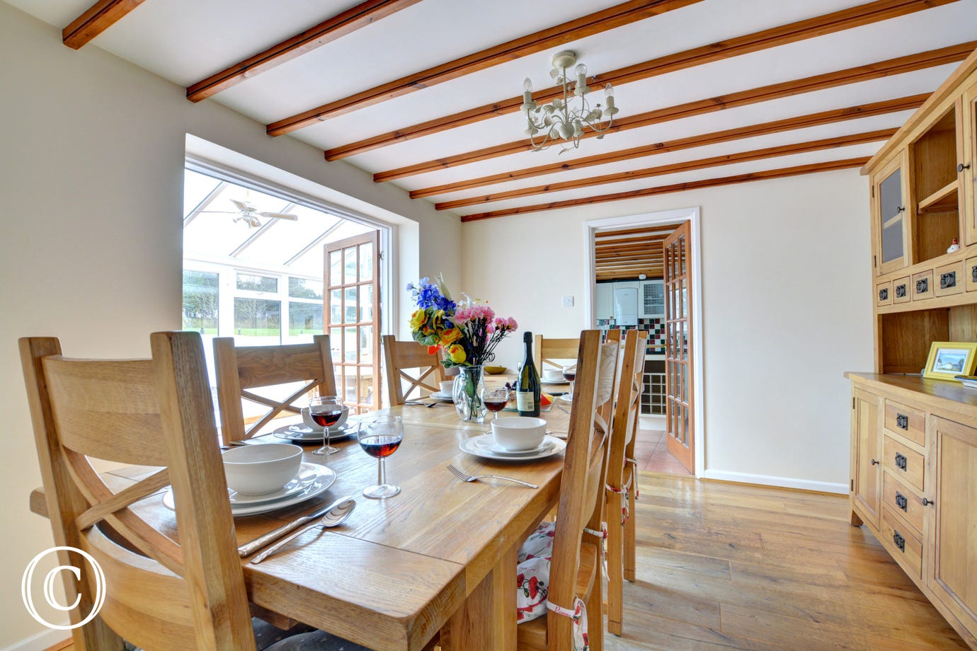 Dining room with french doors leading to conservatory