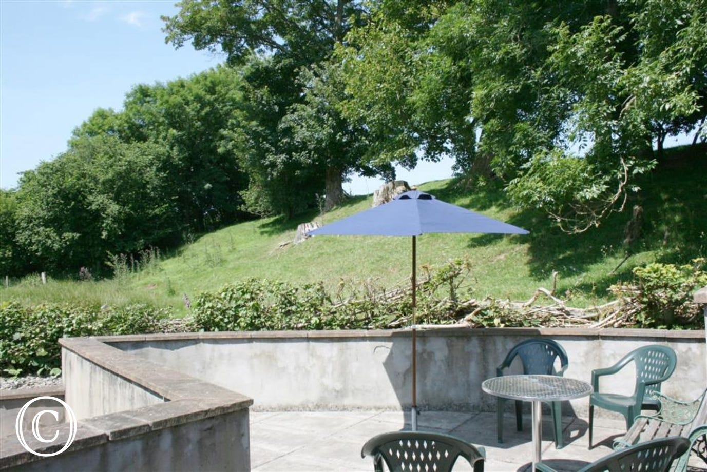 There is a flagged patio with garden furniture to the rear, and access to open countryside
