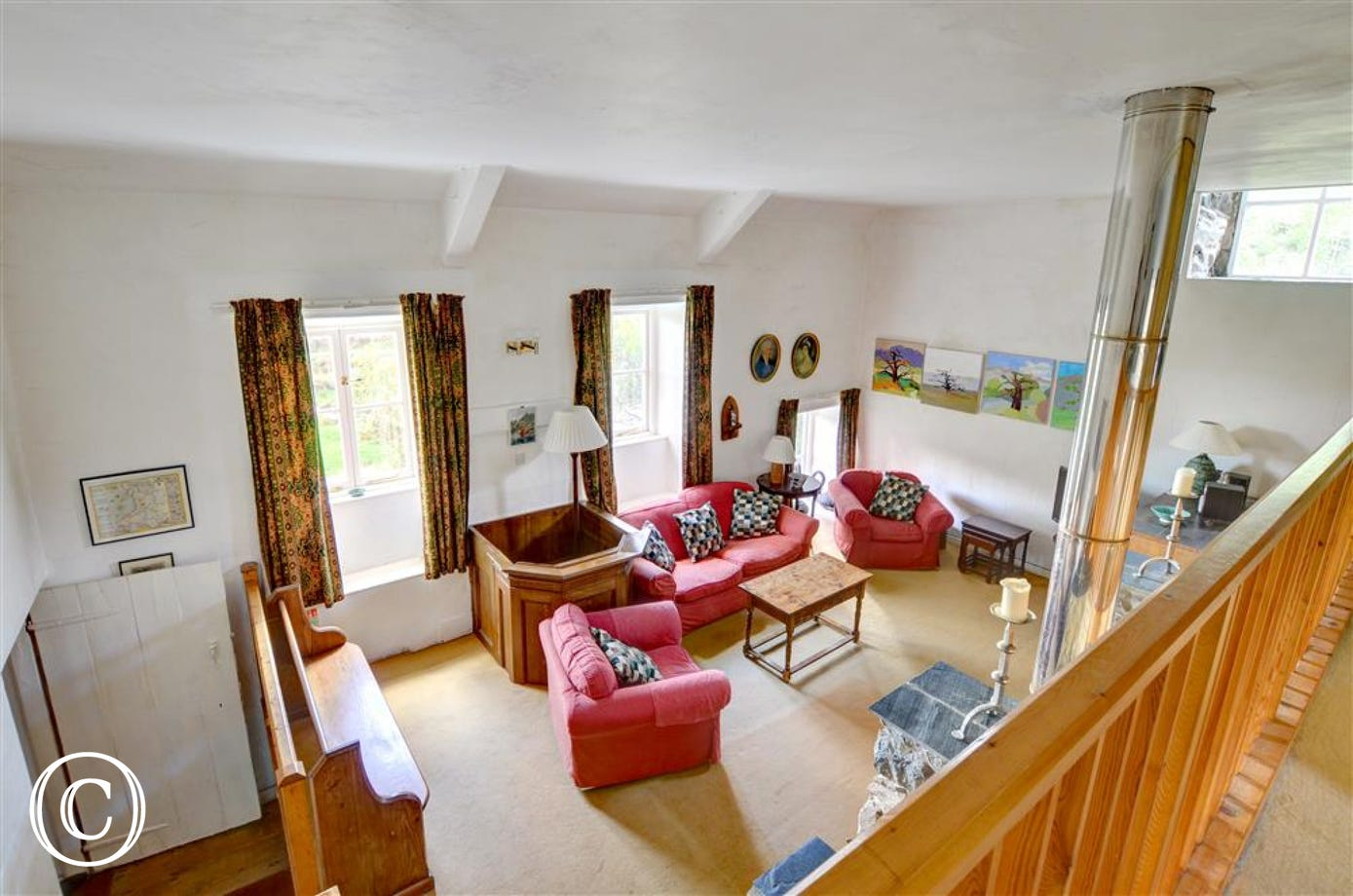 The sitting room, viewed from the galleried bedrooms above