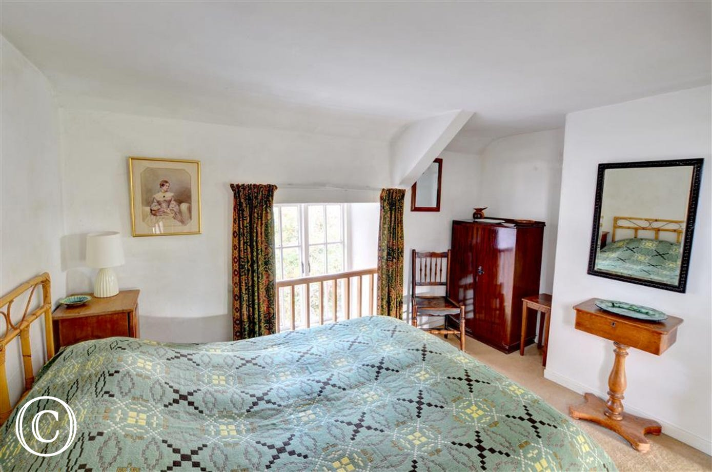 The double bedroom has traditional Welsh wool blanket and traditional furniture