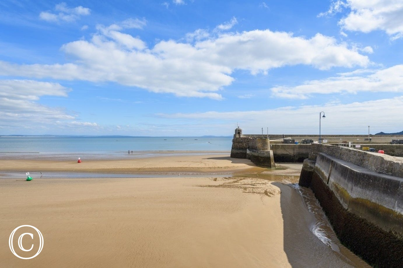 A view of Saundersfoot beach with the tide out.  A lovely expanse of sand.