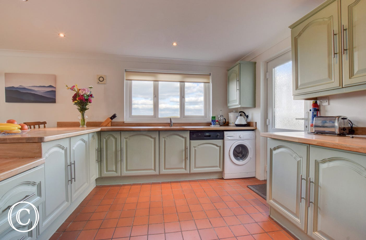 Fully equipped kitchen with views out to sea