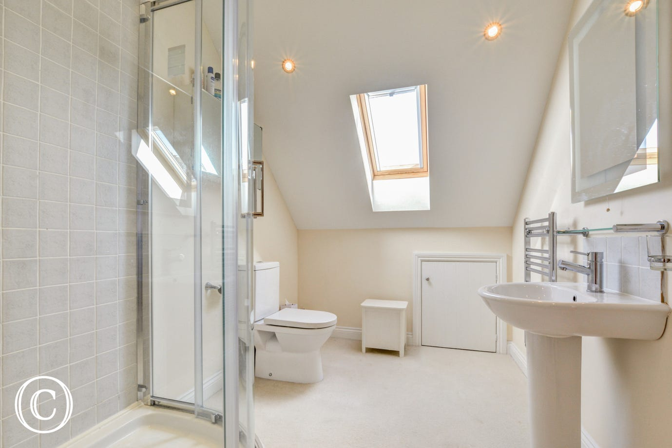 A shower cubicle, toilet & wash basin in this spacious en-suite
