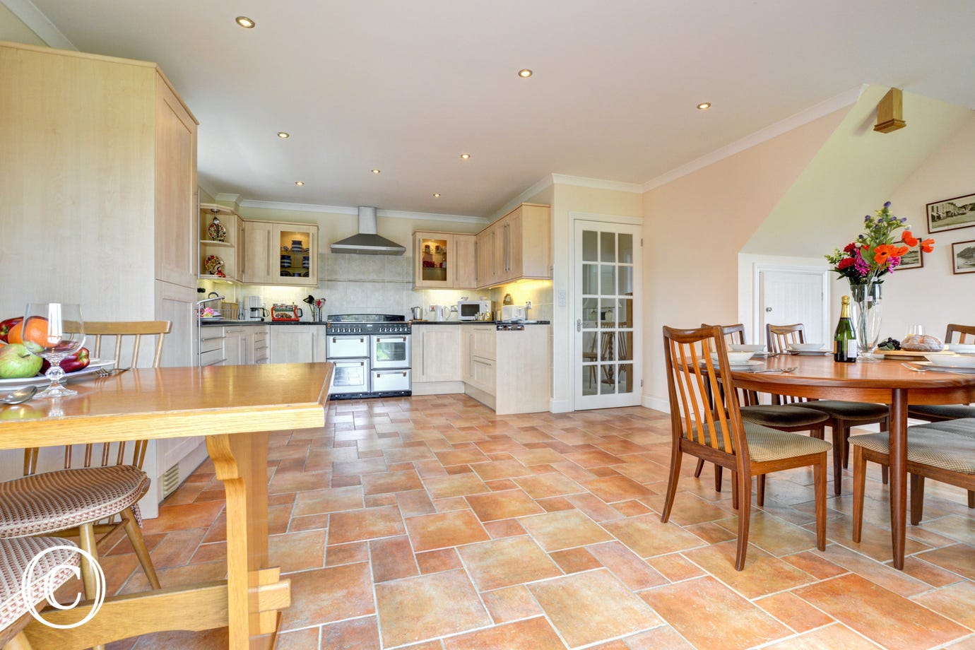 Spacious kitchen area with dining table and a smaller breakfast table & chairs ideal for the children