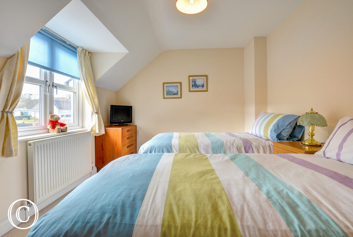 This holiday accommodation provides a twin bedded room
