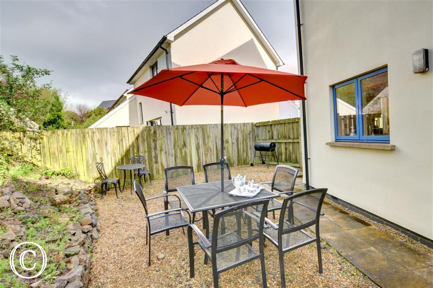 Delightful enclosed rear garden with garden furniture and BBQ